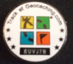 The rear side of the geocoin we found showing the geocaching logo and the unique tracking number allowing the progress of the coin to be recorded as it moves around the world. Click to enlarge