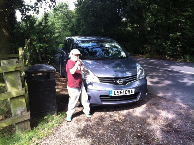 Sam is pictured in front of our car holding his stick ready to tackle the Merry Hill Multi Cache
