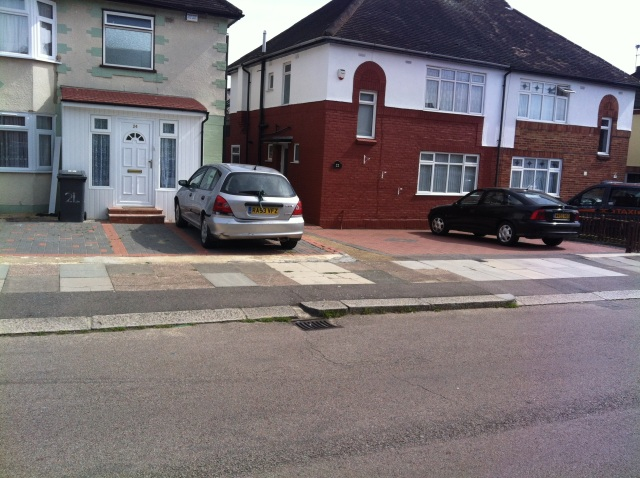 My Childhood home, 22 Brookfield Avenue. Viewed from a slight angle from across the street, this large semi detached house is looking well maintained and the driveway spacious enough for 2 cars looks recently repaved.