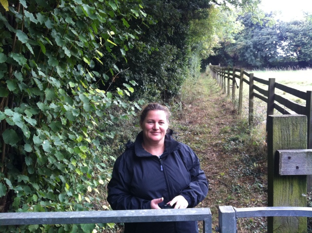 Shar is pictured standing near the kissing gate that delayed our progress at the first cache