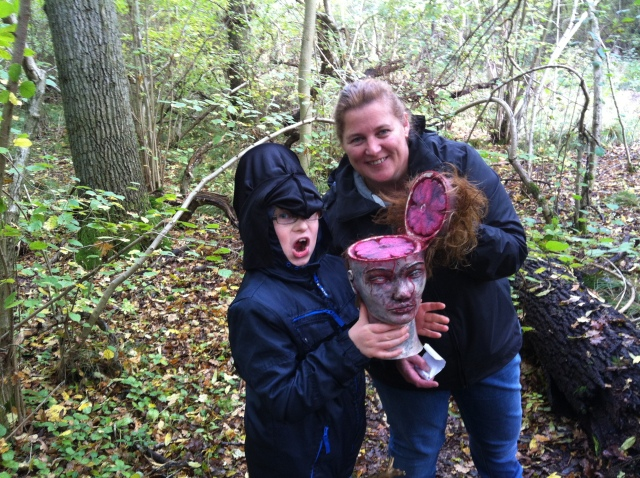 Sam is pictured holding the bad hair day cache, a severed head with flip top scalp