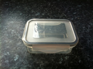 A clear plastic container with clip tabs on the lid to seal it