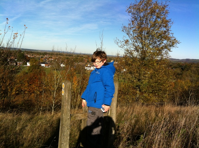 Sam is pictured standing on top of a wooden step-up with the picturesqueview of hertfordshire and buckinghamshire in the background.
