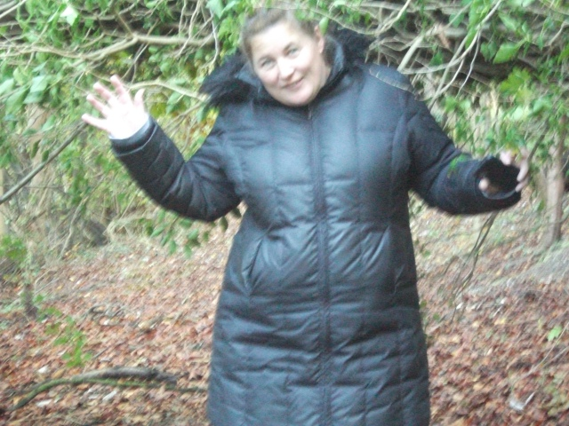 Shar is pictured under a fallen tree that is straddling the path. Picture taken by Sam.