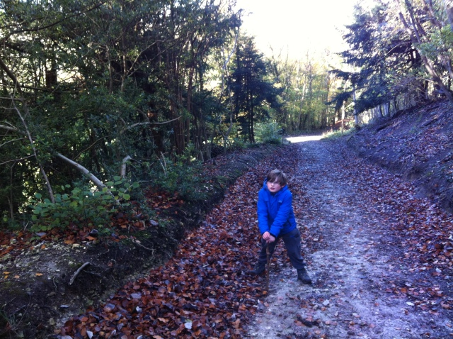 Sam is pictured walking up the steep hill towards cache number 5