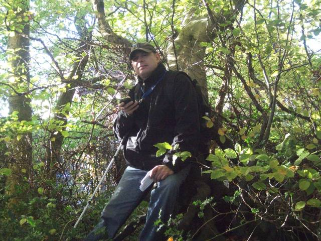Paul is pictured sitting on a log near cache number 6. Picture taken by Sam