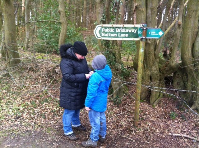 Sam and Shar are pictured in front of a sign for the Bottom Lane Bridle path.