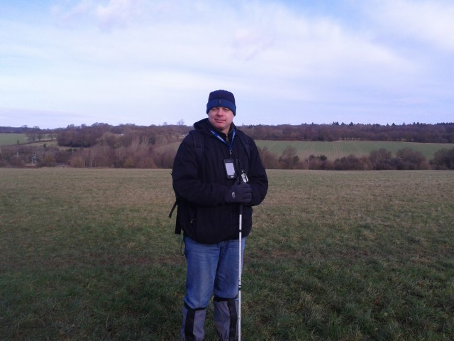 Paul stands on the common that stretches out into the distance rolling open spaces.