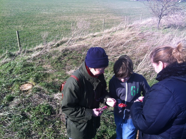 Sam is pictured holding the mushroom cache as Shar and mum look on.