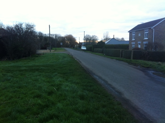 A view down the lane from the last cache as the light fades.