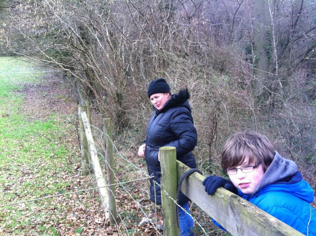 Sam and Shar inspect the cache near the electrified fence.