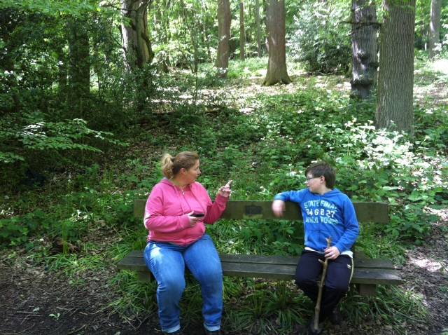 Sam and Shar sit on the bench whilst we take a bearing in order to find the next clue hidden somewhere in the woods