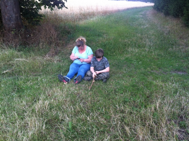 Sam and Shar take a break sitting on the grass near the GZ of The Grange