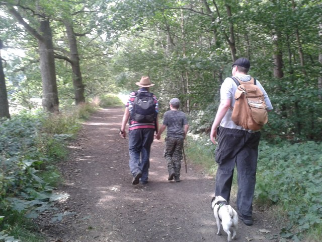 Sam and Paul walk holding hands and Geoof walks with SMokey at his side. Everyone is walking away from teh came along a long path into the distance.