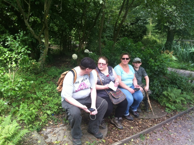 Geoff, Melissa, Sharlene, Sam and Smokey all sit on a bench at teh end of a hot and hilly days caching