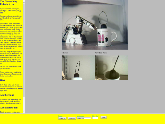 A screenshot of a web page that displays three webcam views of the geocaching robotic arm along with the controls needed to manipulate it.