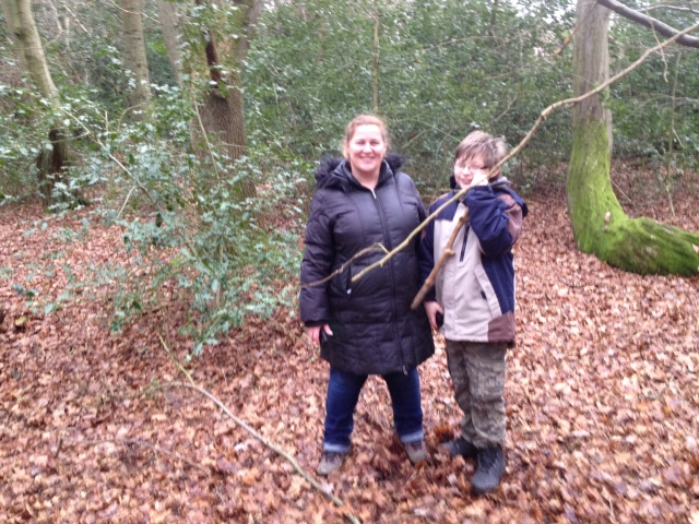 Sam and Shar are pictured in the woods posing.