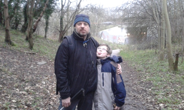 Sam and Paul are pictured standing side by side on School Lane. Sam is looking up at Paul poking his tongue out and Paul is pulling an equally silly face at the camera.