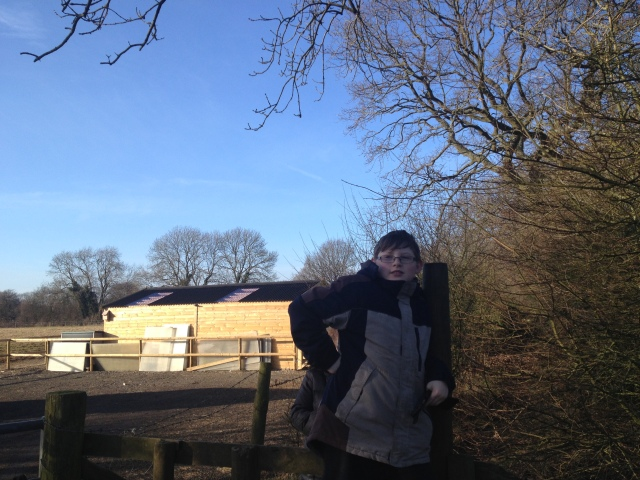 Sam stands atop one of the many stiles we encountered