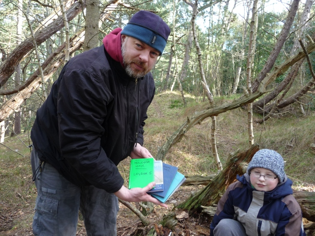 Paul stands at the GZ of Holkham Haul, the oldest caches in Norfolk, holding 5 hard backed log books
