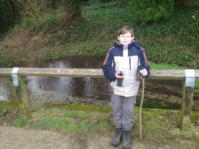 Sam stands at the side of a path in a park holding his new trackable Super Stick mark II