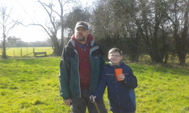 Paul and Sam stand in a field just after lunch