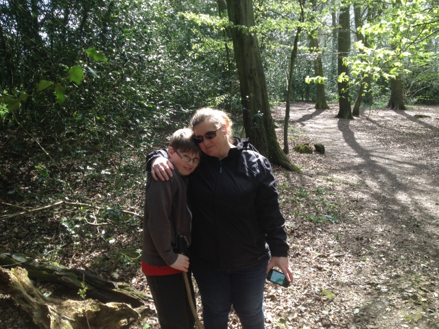 Shar and Sam hug affectionately in the woods after a tricky find.