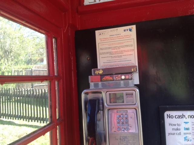 A piicture of the interior of the phonebox shows three VHS video tapes stacked on top of the telephone