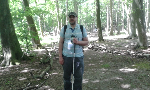 Paul stands in the woods.