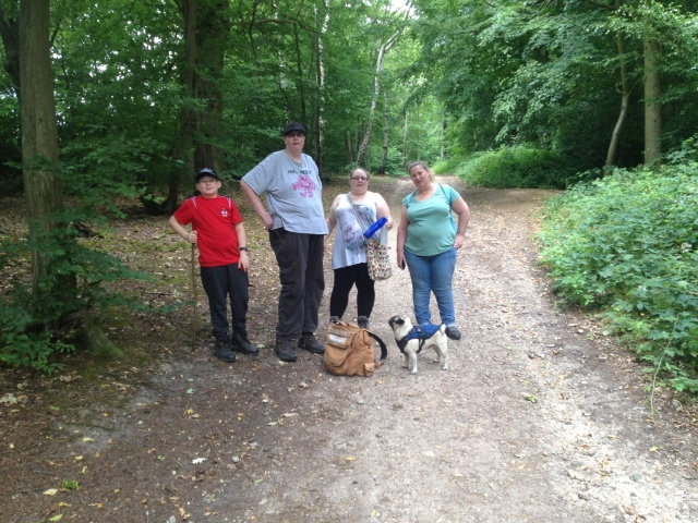 Geoff, Melissa, Sam, Shar and Smokey are pictured posing for a group photo on the path in the woods