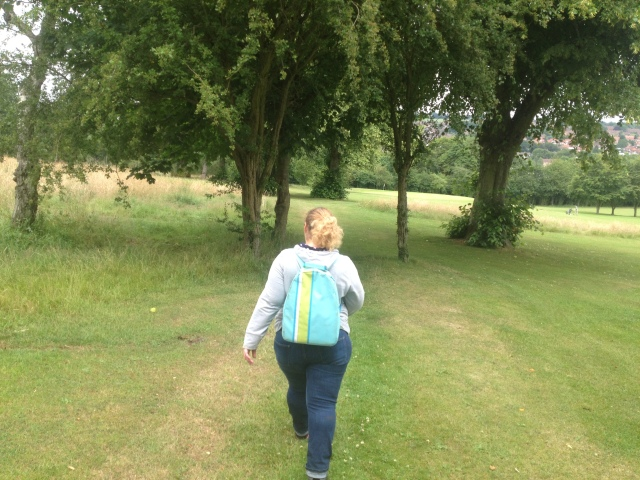 Sharlene walks across the golf course