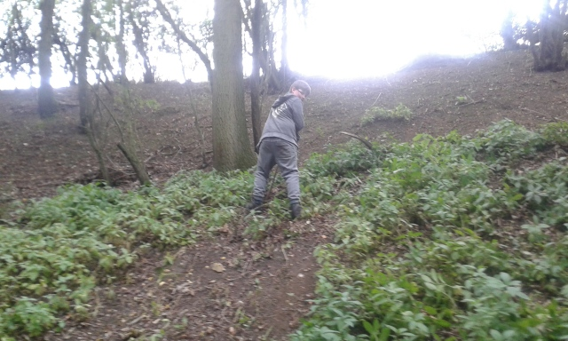 Sam is pictured making his way carefully down the steep bank