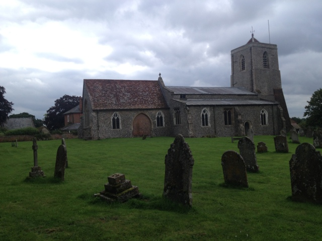 This picture shows the Church at Sandon and a view of numerous graves surrounding it.