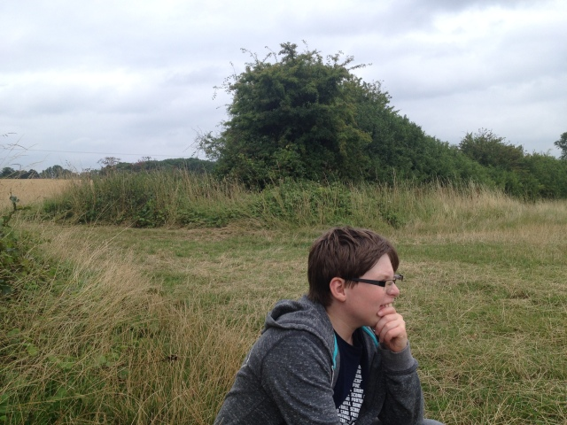 Sam is pictured on teh village green at Sandon. He is staring off into the distance a look of concern on his face.