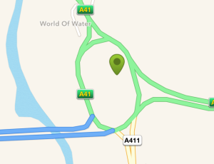 This image shows a map of a large roundabout intersection where the A41 comes in from the right hand side and leaves to the north while the M25 leaves to the west of the roundabout. In the middle of the roundabout is a geocache icon.