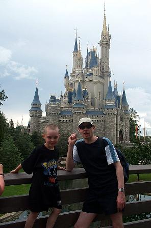 Paul and Jake stand in front of the Magic Kingdom Castle