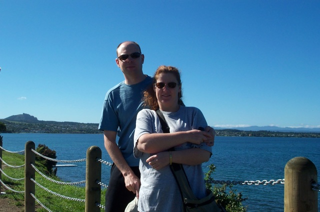 Paul and Sharlene stand in front of the shimmering expanse of Lake Taupo