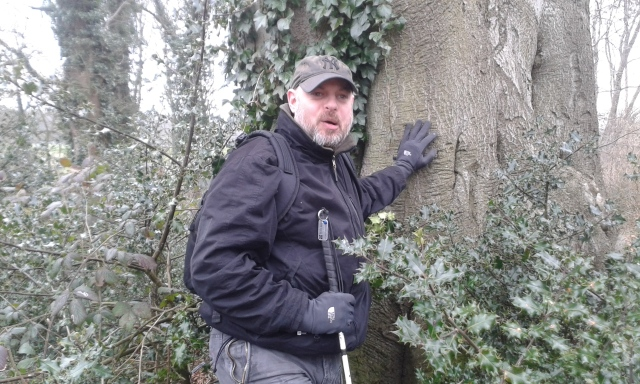 Paul poses in amongst the holly with a mock expression of pain on his face