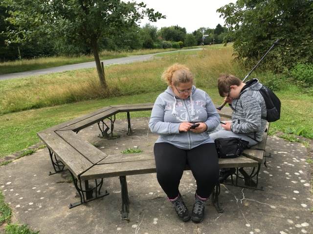Sam and Shar sit on benches after enjoying a picnic lunch